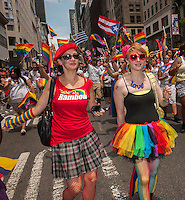 Thousands of marchers and spectators turn out for the 44th annual Lesbian, Gay, Bisexual and Transgender Pride Parade on Fifth Avenue in New York on Sunday, June 30, 2013. The turn out for the parade was especially large with the recent Supreme Court decision overturning the Defense of Marriage Act (DOMA) and California's Proposition 8.  (© Richard B. Levine)