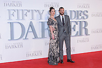 www.acepixs.com<br /> <br /> February 9 2017, London<br /> <br /> Dakota Johnson and Jamie Dornan arriving at the UK Premiere of 'Fifty Shades Darker' at the Odeon Leicester Square on February 9, 2017 in London, United Kingdom. <br /> <br /> By Line: Famous/ACE Pictures<br /> <br /> <br /> ACE Pictures Inc<br /> Tel: 6467670430<br /> Email: info@acepixs.com<br /> www.acepixs.com