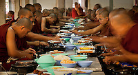 Monks eating lunch at a monastery in Mandalay