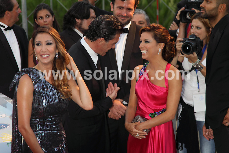 **ALL-ROUND PICTURES FROM SOLARPIX.COM**.**SYNDICATION RIGHTS FOR UK, AUSTRALIA & NEW ZEALAND ONLY**.The Starlite Gala was held at the Hotel Villa Padierna, the same hotel which this week hosted Michelle Obama and her daughter Sasha while on holiday in the Costa del Sol. The charitable event was to benefit 3 foundations: Eva Longoria's Eva's Heroes, which will fund 50 programs of activities for children with special needs Children Joy, founded by Alejandra German and Sandra Garcia-Sanjuan, which will use the funds to build a school for 300 children in Mexico and the Foundation Favors Tears and Antonio Banderas, which will cover 30 scholarships for students of the University of Malaga, Banderas' home town. Marbella, Spain. 7 August 2010..This pic: Antonio Banderas and Eva Longoria Parker..JOB REF:  11865 SKX      DATE:  07_08_2010.**MUST CREDIT SOLARPIX.COM OR DOUBLE FEE WILL BE CHARGED**.**MUST NOTIFY SOLARPIX OF ONLINE USAGE**.**CALL US ON: +34 952 811 768 or LOW RATE FROM UK 0844 617 7637**