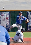March 10, 2012:   UC Santa Barbara Gauchos second baseman Joe Woodward turns a double play against the Nevada Wolf Pack as Carlos Escobar Jr. slides into second during  their NCAA baseball game played at Peccole Park on Saturday afternoon in Reno, Nevada.