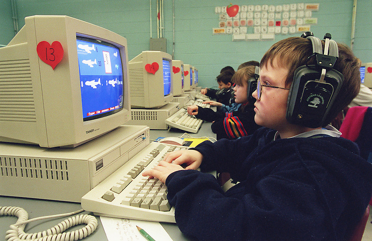 2/18/98.EDUCATION--Third grader Jared Ison uses software developed by Jostens Learning Corporation during math and reading exercises in the computer lab at Stanton Elementary School in Stanton, Ky. The computers and software were obtained by the school as a result of the Kentucky Education Reform Act of 1990..CONGRESSIONAL QUARTERLY PHOTO BY SCOTT J. FERRELL