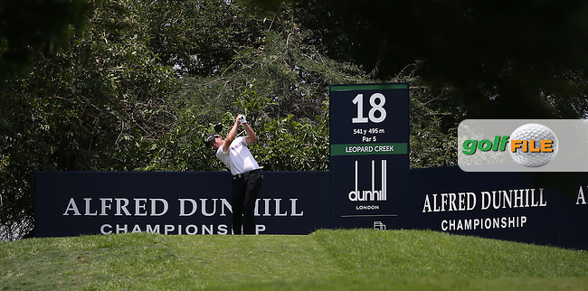 Thriston Lawrence (RSA) drives from the 18th tee during the practice day ahead of 2014 Alfred Dunhill Championship at the Leopard Creek Country Club, Malelane, Mpumalanga, South Africa. Picture:  David Lloyd / www.golffile.ie