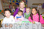 Enjoying their first day at Educate Together Tralee with Teacher Deidre Clifford on Monday were l/r Brendan Wang-Timothy, Vanessa Gyngova, Maia Landers-Commane and Jana Minova............................................................................................................................................................................................................................................................... ............