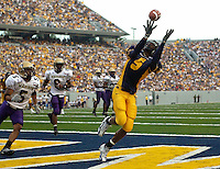 25 September 2004:  Chris Henry (5), West Virginia WR, catches a TD pass in the end zone during the 2nd quarter.&amp;#xD;&amp;#xD;West Virginia defeated James Madison 45-10 at Mountaineer Field at Milan Puskar Stadium in Morgantown, WV.&amp;#xD;Mandatory Credit: Randy Litzinger&amp;#xD;&amp;#xD;<br />