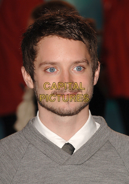 "ELLIJAH WOOD.Attending the UK film premiere of ""Happy Feet"", .Empire Leicester Square, London, England,.26th November 2006..portrait headshot beard .CAP/ BEL.©Tom Belcher/Capital Pictures."