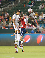 CARSON, CA – OCTOBER 9: Toronto FC defender Adrian Cann and Chivas USA forward Justin Braun (17) during a soccer match at Home Depot Center, October 9, 2010 in Carson California. Final score Chivas USA 3, Toronto FC 0.
