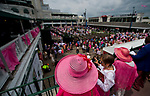 LOUISVILLE, KY - MAY 04: A woman wearing a pink fascinator looks over the entrance on Kentucky Oaks Day at Churchill Downs on May 4, 2018 in Louisville, Kentucky. (Photo by Scott Serio/Eclipse Sportswire/Getty Images)