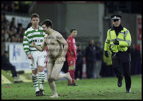 Aberdeen V Celtic - Tennents Scottish Cup 5th Round - at Pittodrie -  not the fastest men on the park... a streaker is pursued by a policeman ....  picture by Donald MacLeod 25.02.02