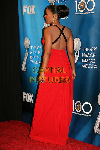 SANAA LATHAN.40th Annual NAACP Image Awards - Press Room at the Shrine Auditorium, Los Angeles, California, USA..February 12th, 2009.full length long red maxi dress black criss cross straps back behind rear beehive hair .CAP/ADM/BP.©Byron Purvis/AdMedia/Capital Pictures.