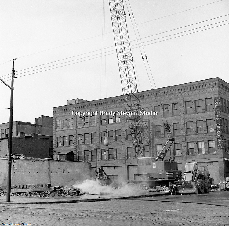 Pittsburgh PA:  The ongoing demolition of distressed buildings in the strip district to create revenue generating parking lots and areas for future development.<br />