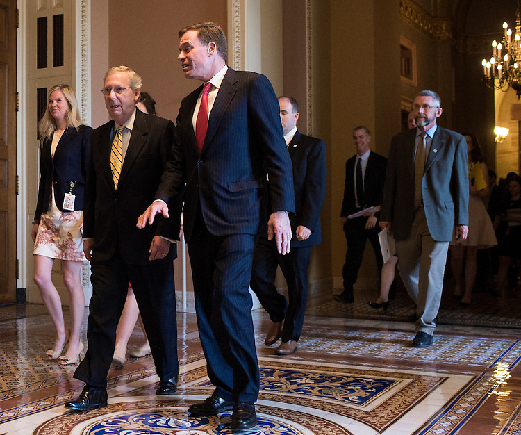 UNITED STATES - MAY 19: Senate Majority Leader Mitch McConnell, R-Ky., and Sen. Mark Warner, D-Va., walk to their news conference in the Ohio Clock Corridor with small business owners from Ohio, Wisconsin and Kentucky to discuss trade on Tuesday, May 19, 2015. (Photo By Bill Clark/CQ Roll Call)