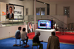 October 16, 2012. Raleigh, North Carolina.. Locals gathered at the Contemporary Art Museum to see artist Jonathan Horowitz's simultaneous exhibitions about the presidential election titled ?Your Land/My Land?..  A room is divided in two, with blue carpet, democrats on one side, and red carpet, republicans, on the other. TV's on both sides are supposed to play either FOX news, red, or CNN, blue. Because of the audio delay between the 2 channels, both sides played CNN during the 2nd presidential debate..