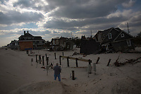 New Jersey, United States. 25th Feb, 2013 -- A man takes pictures of buildings destroyed almost 4 months ago by Sandy Storm at Jersey Shore in New Jersey. Photo by Eduardo Munoz Alvarez / VIEWpress.