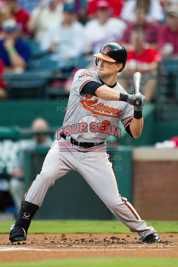 Baltimore Orioles outfielder Nate McClouth #9 swings during the Major League Baseball game against the Texas Rangers on August 21st, 2012 at the Rangers Ballpark in Arlington, Texas. The Orioles defeated the Rangers 5-3. (Andrew Woolley/Four Seam Images).