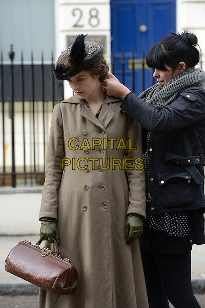 Aisling Loftus<br /> On the set of 'Mr Selfridge' series 2 in London, England, UK, <br /> 19th September 2013.<br /> half length vintage costumes costume drama acting scene filming film set filmset period victorian brown assistant hair hat bag green gloves <br /> CAP/IA<br /> &copy;Ian Allis/Capital Pictures