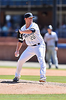 Asheville Tourists pitcher Sam Thoele (26) delivers a pitch during a game against the Charleston RiverDogs at McCormick Field on July 10, 2016 in Asheville, North Carolina. The Tourists defeated the RiverDogs 4-2. (Tony Farlow/Four Seam Images)