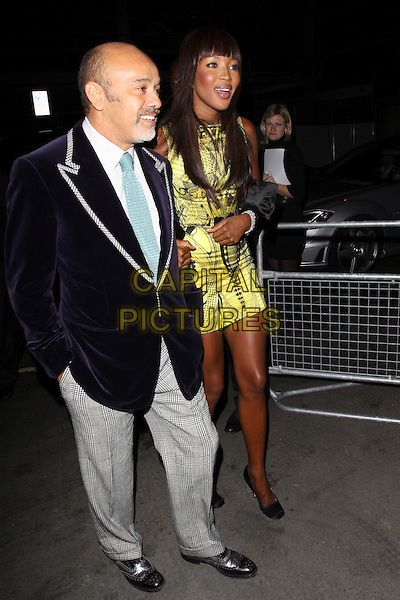 GUEST & NAOMI CAMPBELL.The Vogue Dinner Party at La Caprice Restaurant, London, England..September 21st, 2009.full length black yellow mini dress sleeveless print pattern grey gray trousers blue suit jacket mouth open.CAP/AH.©Adam Houghton/Capital Pictures.