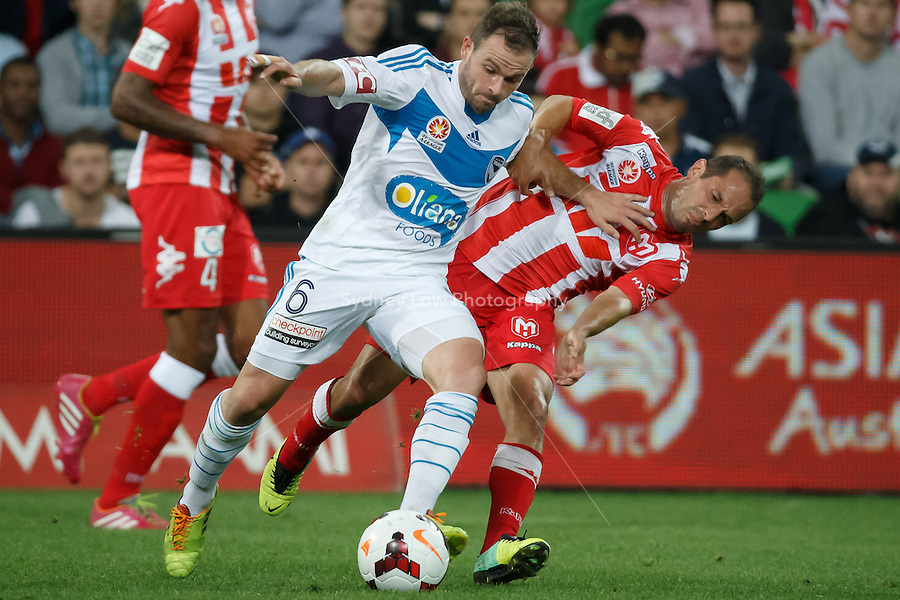 Leigh BROXHAM of the Victory wins the ball in the round 21 match between Melbourne Heart and Melbourne Victory in the Australian Hyundai A-League 2013-24 season at AAMI Park, Melbourne, Australia. Photo Sydney Low/Zumapress<br /> <br /> This image is not for sale on this web site. Please visit zumapress.com for licensing