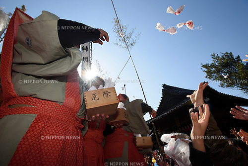 FEBRUARY 11, 2016 - People reach for candy during Oni Matsuri, a demon festival at Akumi Kanbe Shinmeisha Shrine in Toyohashi, Japan. Oni Matsuri, in which two people dressed as a goblin and a demon perform a choreographed battle, celebrates the coming of Spring, and people are showered with sweets and flour. Getting covered with flour is considered especially lucky, as festival story says it will keep you healthy in the summer months. (Photo by Ben Weller/AFLO) (JAPAN) [UHU]