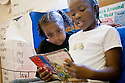 At the New School, in South Seattle, at least an hour a day is spent by the children reading to themselves, or to one another.