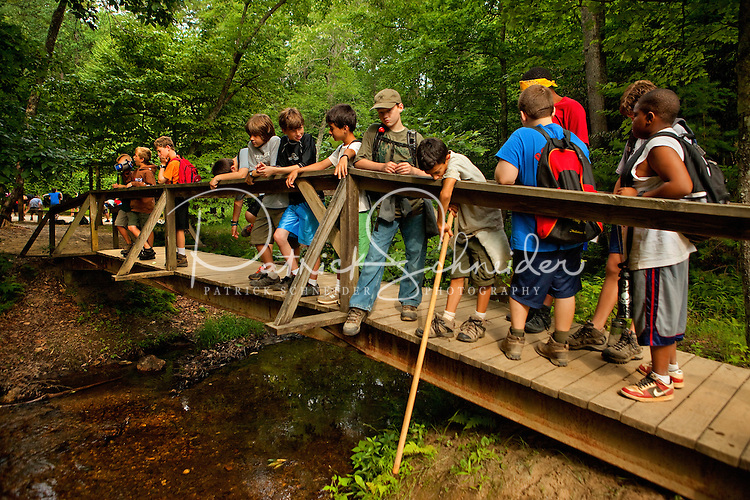 Boy Scouts attending Boy Scout resident camp at Camp Raven Knob in summer 2010 on a hike. Camp Raven Knob Scout Reservation, one of the largest Boy Scout camps in the United States, is located within Boy Scouts of America's Old Hickory Council in Mt. Airy, North Carolina. Troops from across the US attend the camp's one-week residential boys' summer programs, which offer instruction on more than 40 merit badges, adventure programs and new Scout orientation.