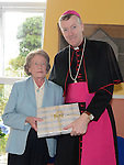 Marie Meade of Slane Historical Society makes a presentation to Bishop Denis Nulty after he celebrated mass at the Church of St Patrick Slane. Photo:Colin Bell/pressphotos.ie