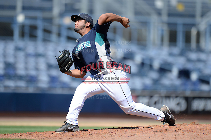 Seattle Mariners pitcher Michaelangelo Guzman (64) during an Instructional League game on October 4, 2013 at Peoria Stadium in Peoria, Arizona.  (Mike Janes/Four Seam Images)