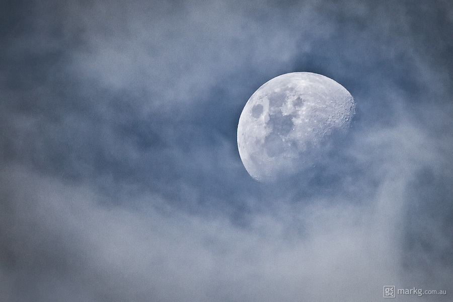 The moon rises amongst the clouds mid afternoon over Wellington, New Zealand