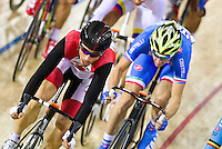 17 FEB 2012 - LONDON, GBR - Canada's Zach Bell (CAN) (in black and red) keeps towards the head of the pack during the Men's Omnium Elimination Race at the UCI Track Cycling World Cup, and London Prepares test event for the 2012 Olympic Games, in the Olympic Park Velodrome in Stratford, London, Great Britain .(PHOTO (C) 2012 NIGEL FARROW)