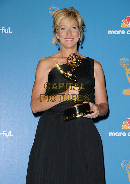 EDIE FALCO.The 62nd Annual Primetime Emmy Awards held at Nokia Theatre L.A. Live in Los Angeles, California, USA. 29th August 2010.half length trophy winner black one shoulder dress .CAP/RKE/DVS.©DVS/RockinExposures/Capital Pictures.