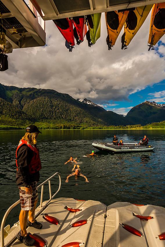 "Polar bear plunge , Un-Cruise small cruise ship ""Wilderness Explorer"" in Nakwasina Sound,  Inside Passage, Southeast Alaska USA."