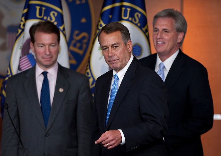 UNITED STATES - JULY 28: Speaker of the House John Boehner, R-Ohio, flanked by Rep. Peter Roskam, R-Ill., and House Majority Whip Kevin McCarthy, R-Calif., holds a news conference on the debt ceiling  on Thursday, July 28, 2011. (Photo By Bill Clark/Roll Call)