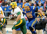 BROOKINGS, SD - OCTOBER 3:  Andrew Bonnet #46 from North Dakota State looks for room as Shayne Gottlob #98 from South Dakota State pursues in the first quarter of their game Saturday night at Coughlin Alumni Stadium in Brookings. (Photo by Dave Eggen/Inertia)