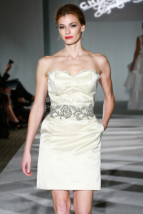 Model walks the runway in a Chaviano Couture Melanie Ann wedding dress by Annette Thurmon, during the Wedding Trendspot Spring 2011 Press Fashion show, October 17, 2010.