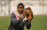 "A Palestinian girl takes part in Baseball training, in Gaza city, on February 20, 2017. Baseball is a bat-and-ball game played between two teams of nine players each, who take turns batting and fielding. Baseball is thought to have originated as a game called ""rounders"" in England and gained popularity in the United States in the early 1900s. It has gone by many names in the past, including ""town ball,"" ""goal ball,"" round ball,"" and simply ""base,"" just to name a few. Photo by Ashraf Amra"