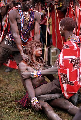 Lolgorian, Kenya. Siria Maasai; Eunoto ceremony; moran in a trance fit.