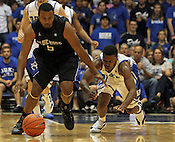 Tyler Thornton dives past Presbyterian's Ryan Hargrave for a loose ball. Duke beat Presbyterian 96-55 on Saturday, November 12, 2011 at Cameron Indoor Stadium in Durham, NC. It was win number 902 for Duke head coach Mike Krzyzewski, tying him with Bob Knight for the NCAA Division I all-time win record. Photo by Al Drago.
