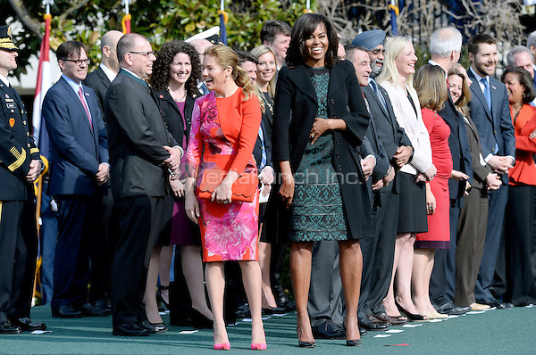 First Lady Michelle Obama and Mrs. Sophie Gr&Egrave;goire Trudeau share a laugh during a ceremony at the White House for an Official Visit March 10, 2016 in Washington,D.C.  <br /> Credit: Olivier Douliery / Pool via CNP/MediaPunch