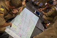 On board the German naval reconnaissance plane, 15 men are bent over a map of the Internationally Recommended¬ Transit Corridor (IRTC), which runs across the Gulf of Aden, a dead-straight, 1,000km-long, two-lane passage heading east through some of the most dangerous waters in the world.  Planning the flight route over the Gulf of Aden, to look for pirates..German Air Force working with Operation Atalanta (EU anti-piracy mission) and OEF (Operation Enduring Freedom) on sea reconnaissance mission using P3 plane with Infra Red cameras and other high tech equipment, to identify potential piracy activities off the coast of Somalia...The geostrategical and geopolitical importance of the Republic of Djibouti, located on the Horn of Africa, by the Red Sea and the Gulf of Aden, and bordered by Eritrea, Ethiopia and Somalia.