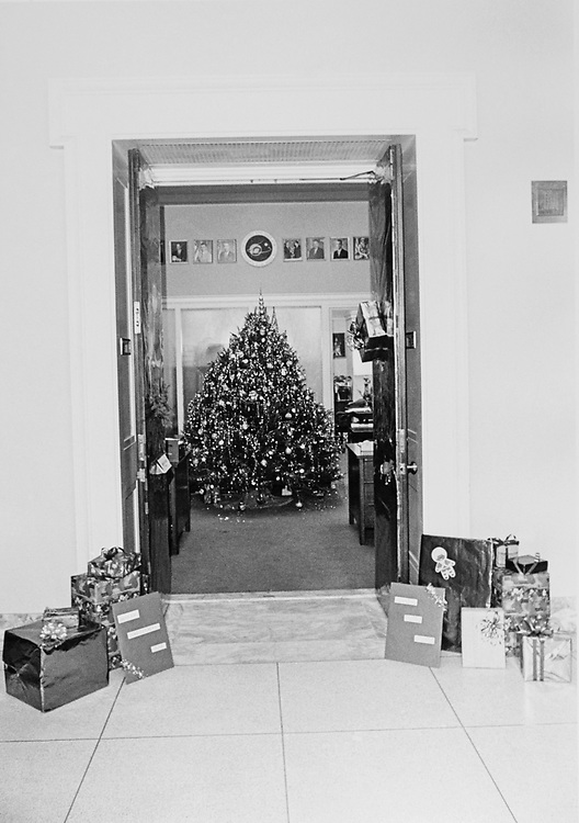 Decorated Congressman's office doorway with gifts around Christmas. (Photo by Dev O'Neill/CQ Roll Call via Getty Images)