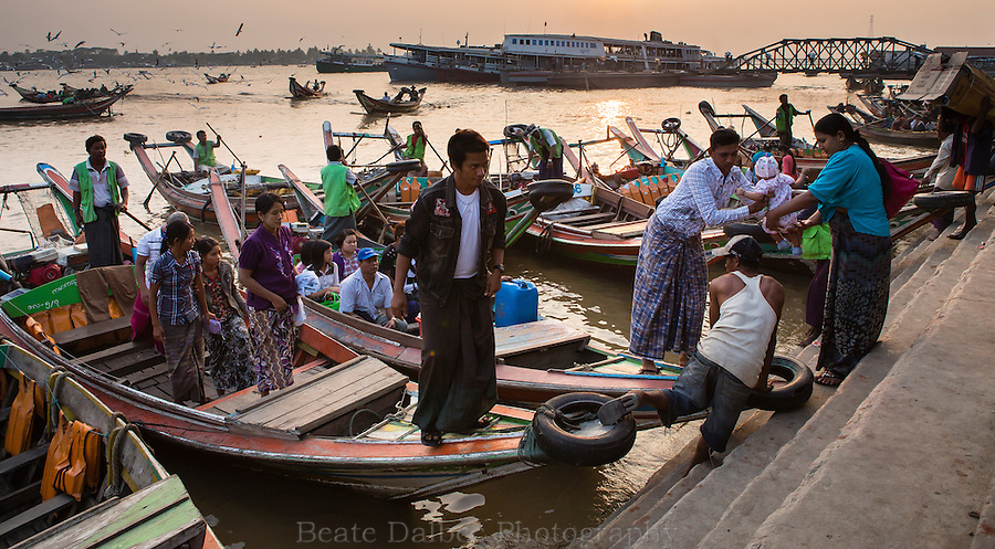 People boarding boats in the harbor of Yangon, Myanmar