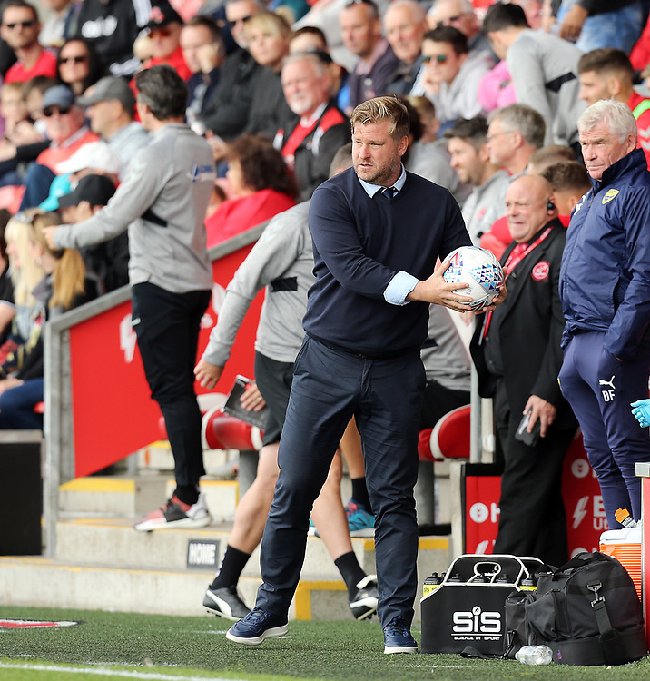 Oxford United manager Karl Robinson recovers the ball in his technical area<br /> <br /> Photographer Rich Linley/CameraSport<br /> <br /> The EFL Sky Bet League One - Fleetwood Town v Oxford United - Saturday 7th September 2019 - Highbury Stadium - Fleetwood<br /> <br /> World Copyright © 2019 CameraSport. All rights reserved. 43 Linden Ave. Countesthorpe. Leicester. England. LE8 5PG - Tel: +44 (0) 116 277 4147 - admin@camerasport.com - www.camerasport.com
