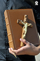 Boy's hand holding the Holy Bible with crucifix  (Licence this image exclusively with Getty: http://www.gettyimages.com/detail/83154248 )