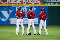 (L-R) Tripp Martin (9), Jose Cardona (8), and Eduard Pinto (2) during the National Anthem prior to the game against the Kannapolis Intimidators at L.P. Frans Stadium on April 23, 2015 in Hickory, North Carolina.  The Crawdads defeated the Intimidators 3-2 in 10 innings.  (Brian Westerholt/Four Seam Images)