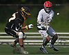 Mike Monitto #9 of Hills East, right, and Bryan Lehman #27 of Commack battle for possession of a loose ball during the Suffolk County varsity boys lacrosse Division I (Class A) quarterfinals at Half Hollow Hills High School East on Friday, May 19, 2017. Hills East won by a score of 11-9.