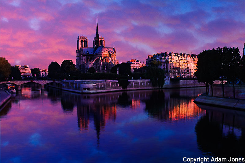 Notre Dame reflected on Seine River at sunrise, Paris, France