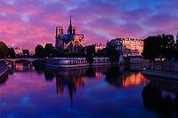 Notre Dame reflected on Seine River at sunrise, Paris, France