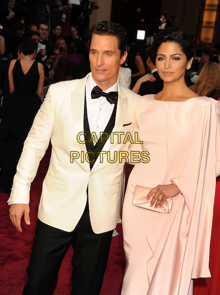 HOLLYWOOD, CA- MARCH 02:  Actor Matthew McConaughey (L) and model Camila Alves attend the 86th Annual Academy Awards held at Hollywood &amp; Highland Center on March 2, 2014 in Hollywood, California.<br /> CAP/ROT/TM<br /> &copy;Tony Michaels/Roth Stock/Capital Pictures