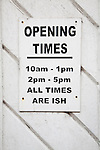 Funny sign for shop opening times, UK